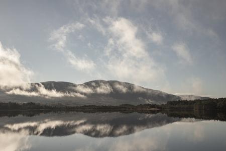Mist rising on Loch Garten in the Cairngorms National Park.