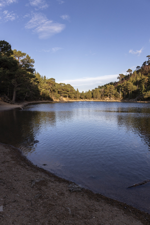Lochan Uaine on the Ryvoan pass at Glen More in the Cairngorms National Park of Scotland. Stock Photo