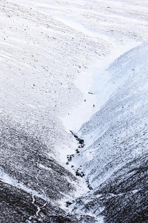 Climbers descending Cairngorm Mountain in Scotland. Stock Photo