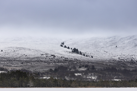 Snow on the Meal a Bhuachaille in the Cairngorms National Park. Stock Photo