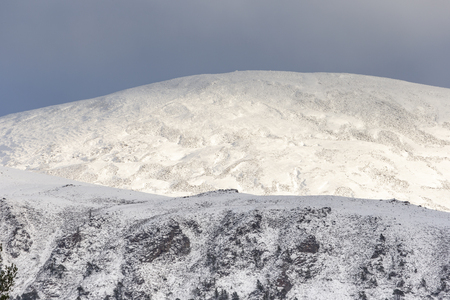Snow on Geal Charn in the Cairngorms National Park of Scotland.