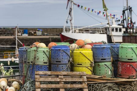 Lobster Pots and Buoys at Gourdon Harbour in Aberdeenshire, Scotland. Stock Photo