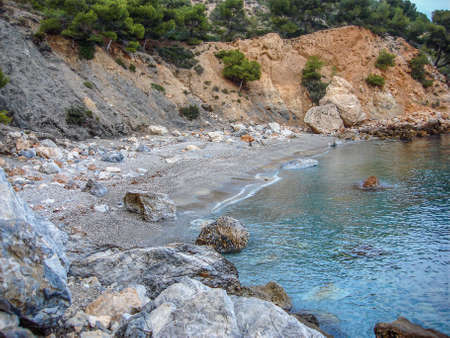 Small, secluded beach in Costa del Sol, Spain, on the Mediterranean Sea