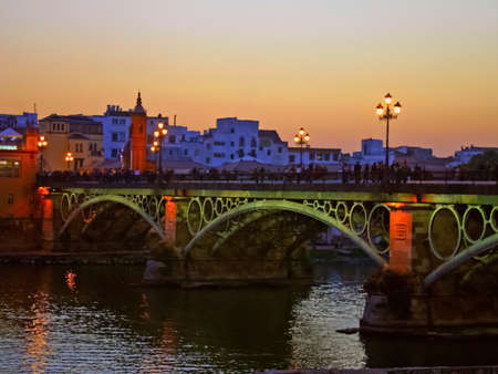 painterly: Painterly image of Seville bridge over Guadalquivir river, Spain at sunset