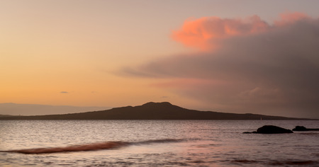 View of Rangitoto Island from Milford beach Auckland New Zealand