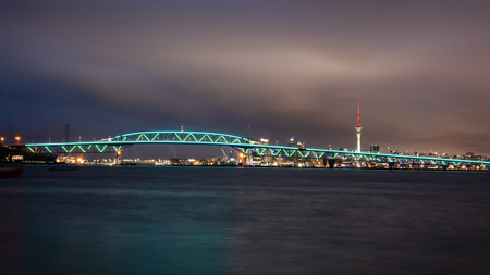 Auckland Harbour Bridge lit up in green lights for Auckland Anniversary to celebrate the citys birthday
