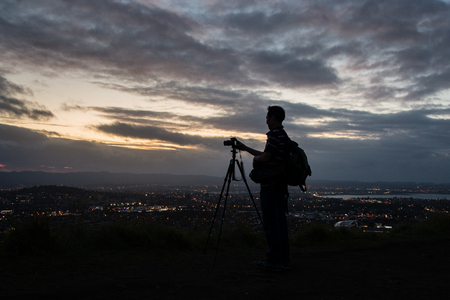 Photographer taking sunset photos at Mount Eden Auckland