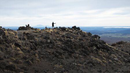 Admiring the view of Mt Taranaki from the track of Tongariro Alpine Crossing