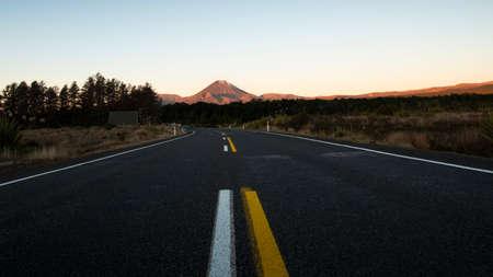 Road towards Mt Ruapehu at sunset in Tongariro National Park, New Zealand
