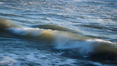 Image of crashing waves at sunset using a slow shutter speed