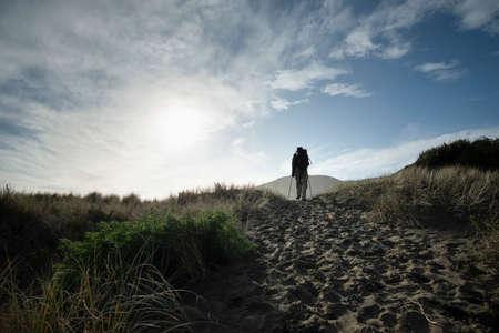 Walking on the black-sand Anawhata beach, Waitakere, New Zealand
