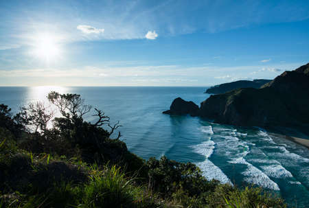 View from Whites beach walkway over the hills from the north end of the Piha beach, Auckland