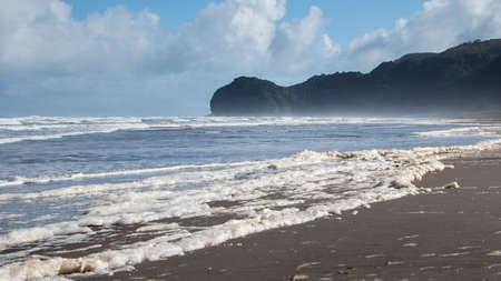 Sea foam on Piha beach, Waitakere, Auckland