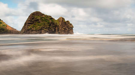 Long exposure image of Piha beach showing the movement of waves