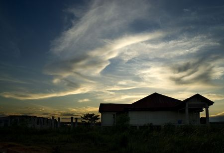 decades: Silhouette image of Matilda House in Punggol, Singapore, during sunset