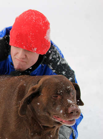 Fun in the snow - Dog with funny face photo