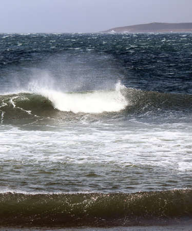 very windy: A sunny but very windy fall day with white top waves