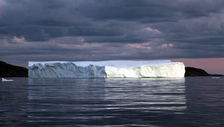Black clouds forming above the iceberg 스톡 콘텐츠