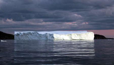 Black clouds forming above the iceberg 版權商用圖片