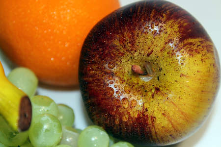 Apple,orange and green grapes Stock Photo
