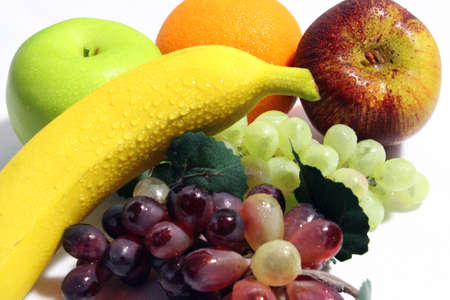 Grapes,apples,banana,and an orange on a white background Stock Photo - 12564579