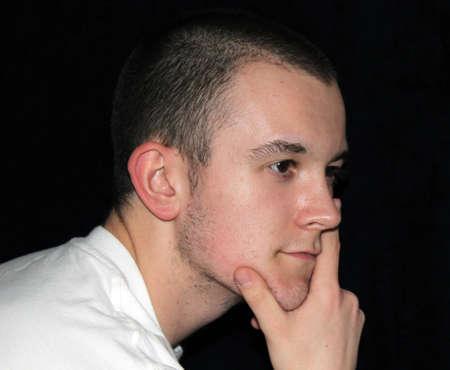 Young Man Thinking Pose Stock Photo - 13432086