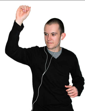 Young man listening to music and dancing silly with one arm in the air photo