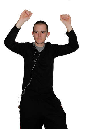 Young man listening to music and dancing silly with arms in the air photo