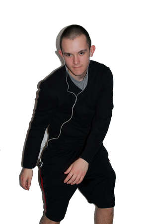 Young man listening to music and dancing silly  photo