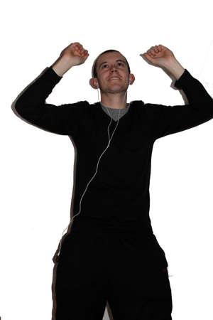 Young man dancing silly with arms up in the air photo