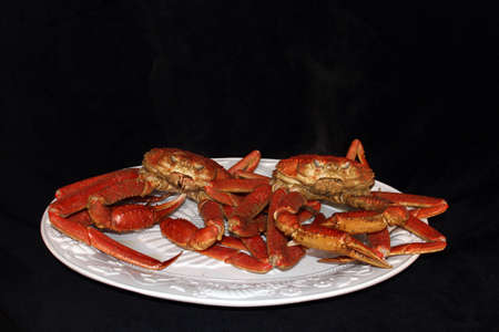 Steamed crab on a platter with black background