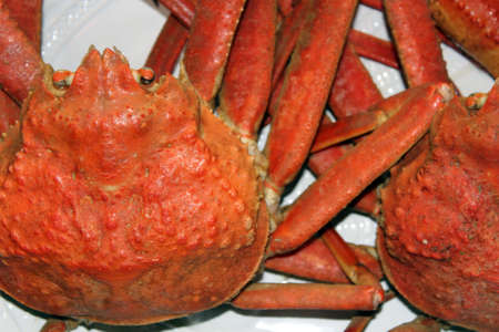 Two crab side by side on a platter