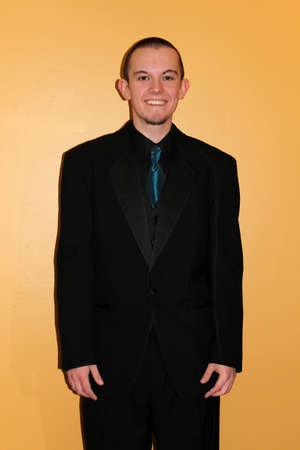 Young man in tuxedo on high school prom day photo