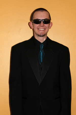 Young man in tuxedo and sunglasses on prom day photo