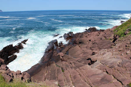 Rugged landscape and the Atlantic ocean on a sunny day in July  photo