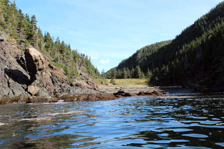 shaped: Sheltered cove and head shaped rock formation