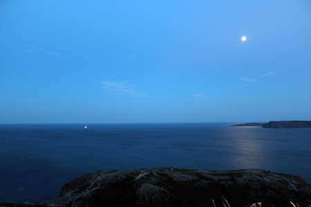 Beautiful moon over the ocean photo