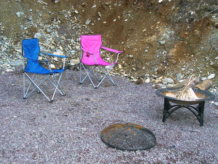 round chairs: Fire pit and folding chairs Stock Photo