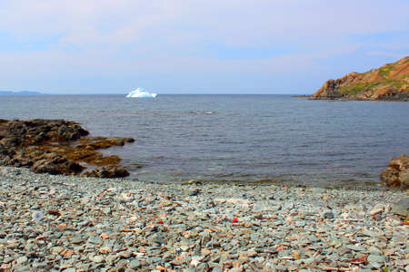 Spring Iceberg and the shoreline photo