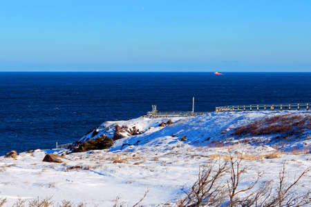 frigid: Beautiful landscape on a sunny winter day with a ship in the distance Stock Photo