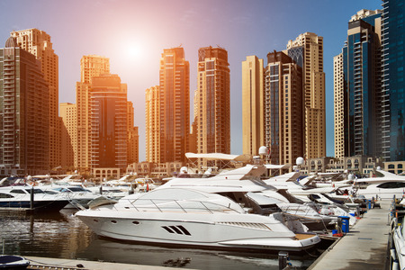 marina: Sea bay with yachts at sunset in Dubai Marina
