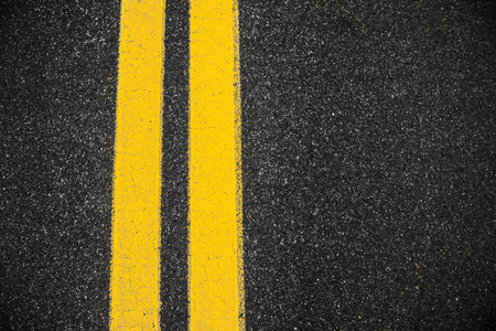 Highway surface with two yellow lines. Asphalt background photo