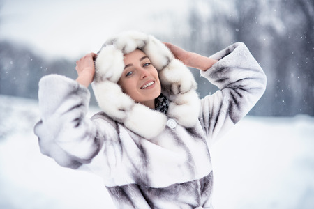 Woman have fun on the snow in winter forest photo