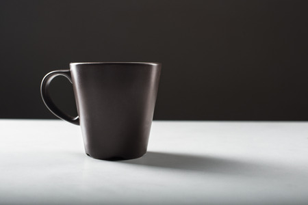 ot: Black coffee cup ot the white table