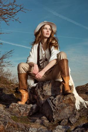 Fashion photo of model woman in mountain 免版税图像