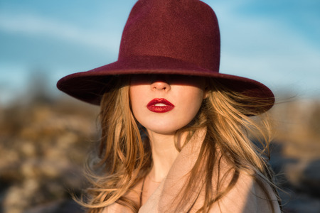 wind up: Portrait of elegant beautiful woman with red lips and hat Stock Photo