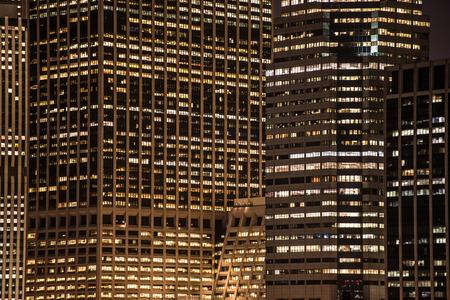 new york night: skyscrapers windows at the night in New York City