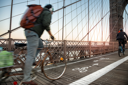 new way: Bicycle road with cyclist on Brooklyn Bridge in New York City Stock Photo