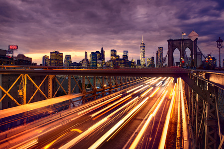 light red: Night car traffic on Brooklyn Bridge in New York City Stock Photo