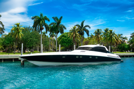 vip: Luxury speed yacht near tropical island in Miami, Florida